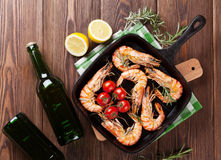 Grilled shrimps on frying pan and beer Stock Photos