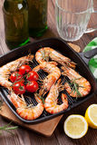 Grilled shrimps on frying pan and beer Royalty Free Stock Photos