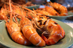 Grilled shrimps on the green dish royalty free stock photography