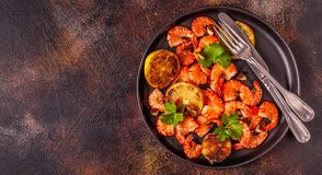 Grilled shrimps with lemon parsley and garlic royalty free stock photography