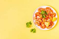 Grilled shrimps with lemon parsley and garlic stock photo