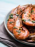 Grilled shrimps on pastel background Royalty Free Stock Image