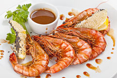 Grilled shrimps on a plate. Stock Photos