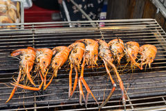 Grilled shrimps, prawns on the flaming grill Royalty Free Stock Images