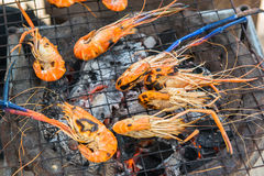 Grilled shrimps on process Royalty Free Stock Images