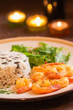 Grilled shrimps with rice. In romantic atmosphere Stock Image