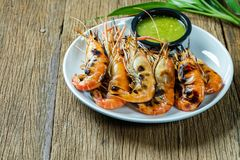 Grilled shrimps on a white plate royalty free stock image