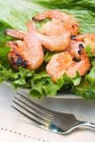 Grilled shrimps served on green salad. Grilled shrimps on plate served with green Romano salad are ready to eat stock photos