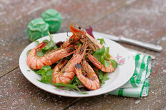 Grilled shrimps served outdoor in winter Stock Photo