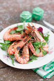 Grilled shrimps served outdoor in winter Royalty Free Stock Photo