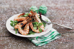 Grilled shrimps served outdoor in winter, toned image Stock Photo