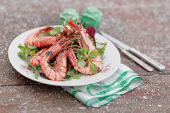 Grilled shrimps served outdoor in winter, toned image Royalty Free Stock Photos