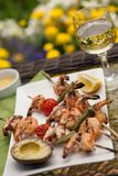 Grilled Shrimps Skewers for Dinner in Garden Royalty Free Stock Images