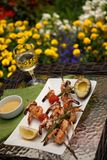 Grilled Shrimps Skewers for Dinner in Garden Stock Photography