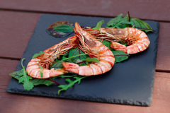 Grilled shrimps on slate plate Royalty Free Stock Photography