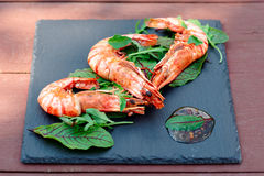Grilled shrimps on slate plate Stock Photo