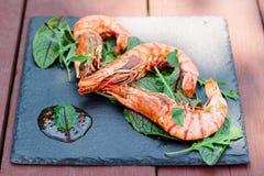 Grilled shrimps on slate plate Stock Image