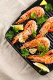 Grilled shrimps with spice, garlic and lemon. Grilled seafood. Langoustines. royalty free stock photography