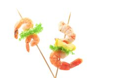 Grilled shrimps on a stick. Royalty Free Stock Image