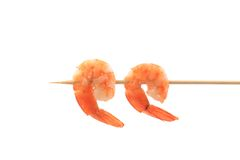Grilled shrimps on a stick. Stock Photos