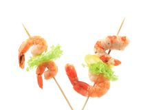 Grilled shrimps on a stick. Royalty Free Stock Images