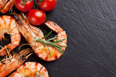 Grilled shrimps on stone plate Stock Images
