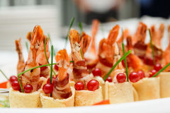 Grilled shrimps wrapped in bacon Royalty Free Stock Photography
