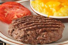 Grilled sirloin patty with au gratin potatos Stock Photos