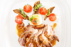 Grilled sirloin steak. With roasted potatoes, spinach, baked tomato mushroom cream sauce or herb butter royalty free stock images