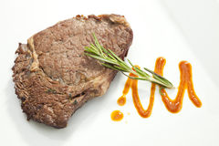 Grilled Sirloin steak with rosemary Royalty Free Stock Photo