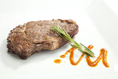 Grilled Sirloin steak with rosemary Royalty Free Stock Photos