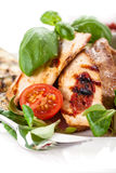 Grilled sirloin with tomato and basil Royalty Free Stock Images