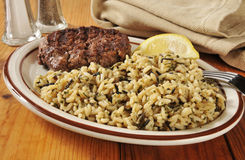Grilled sirloin and wild rice Royalty Free Stock Images