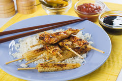 Grilled skewed chicken with baby corn and rice Stock Photo