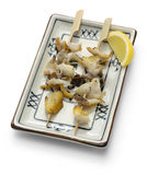 Grilled skewered whelks, japanese food. Isolated on white background Stock Photo