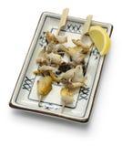 Grilled skewered whelks, japanese food Stock Photo