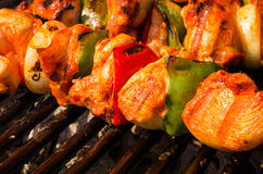 Grilled skewers of meat and vegetables Stock Image