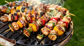 Grilled skewers of meat and vegetables  on grill plate Royalty Free Stock Image