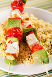 Grilled skewers over rice Stock Photography