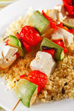 Grilled skewers over rice Stock Photo