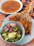 Grilled skewers. Pork satay grilled with peanut sauce stock image