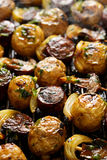 Grilled skewers with potatoes, sausage, mushrooms and onions on grill pan Stock Images