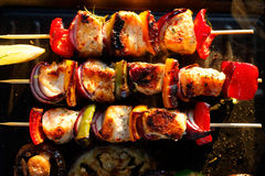 Grilled skewers of salmon and vegetables on a grill Stock Photos