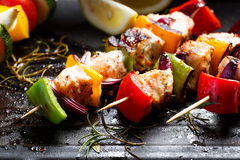 Grilled skewers of salmon and vegetables on a grill pan Stock Image