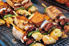 Grilled skewers of seafood Stock Images