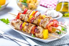 Grilled skewers of vegetables and meat on the Table. stock photo