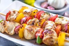 Grilled skewers of vegetables and meat on the Table. stock photos