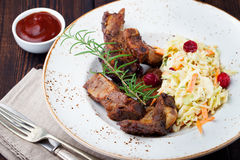 Grilled sliced barbecue pork ribs Salad cole slaw Royalty Free Stock Image