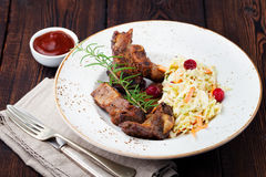 Grilled sliced barbecue pork ribs Salad cole slaw Stock Photo