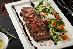 Grilled sliced beef steak with salad on a plate Royalty Free Stock Photography